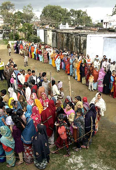 Voters outside a polling centre to cast their vote in Haraiya, UP