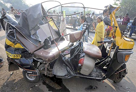A damaged autorickshaw in Pune where a government bus driver sped through the streets smashing his empty bus into dozens of vehicles killing 8 and injuring 30