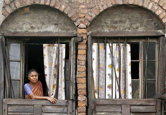 A woman watches a procession in Kolkata