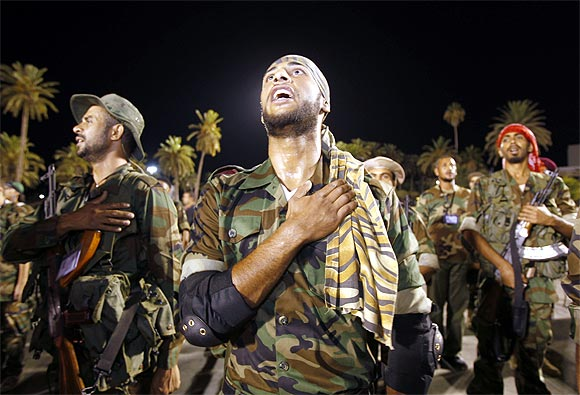 Rebels sing the national anthem of Libya after the fall of Muammar Gaddafi in Tripoli