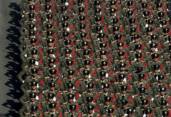 Members of the Iranian Army parade during a ceremony in Tehran
