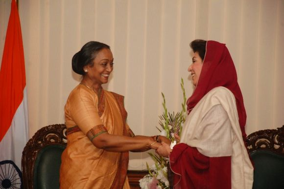Meira Kumar greets Fehmida Mirza during a function at Pakistan national assembly
