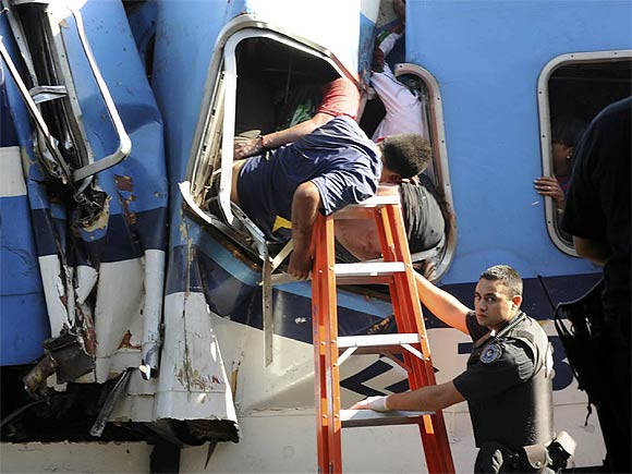 Trapped passengers from a commuter train that crashed into the Once train station at rush hour are seen in a coach in Buenos Aires
