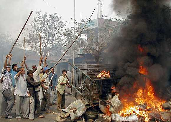 Angry crowds went on a rampage in Ahmedabad, killing Muslims, in reprisal for the Godhra incident'