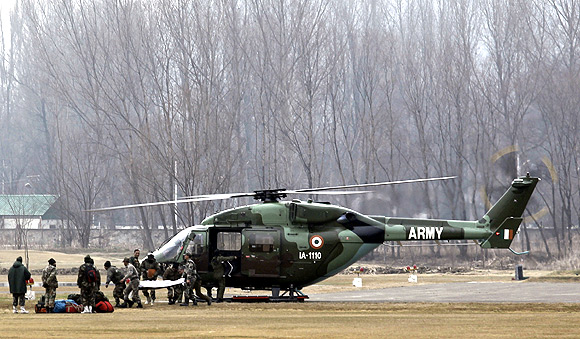 Army soldiers bring down the body of a colleague from a helicopter after the avalanche