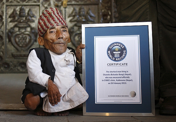 Chandra Bahadur Dangi poses for a picture with his certificate after being announced as the world's shortest man living, as well as shortest person ever measured by the Guinness World Records, in Kathmandu