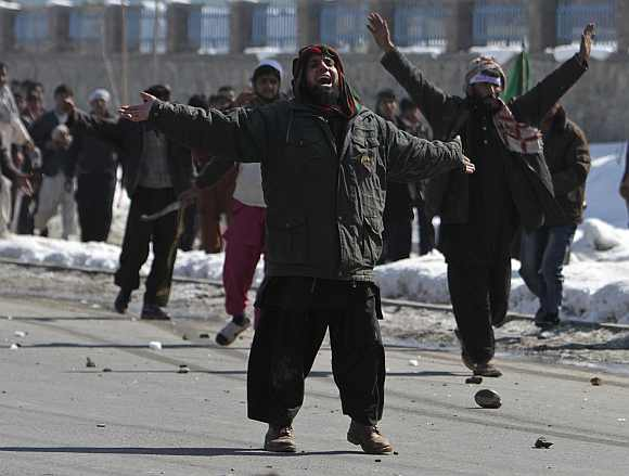 Afghan men shout anti-US slogans during a protest in Kabul