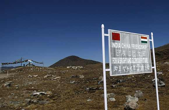 A signboard is seen from the Indian side of the Indo-China border at Bumla, Arunachal Pradesh
