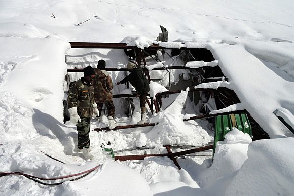 Army personnel during rescue operations at avalanche-hit Sonamarg on Monday