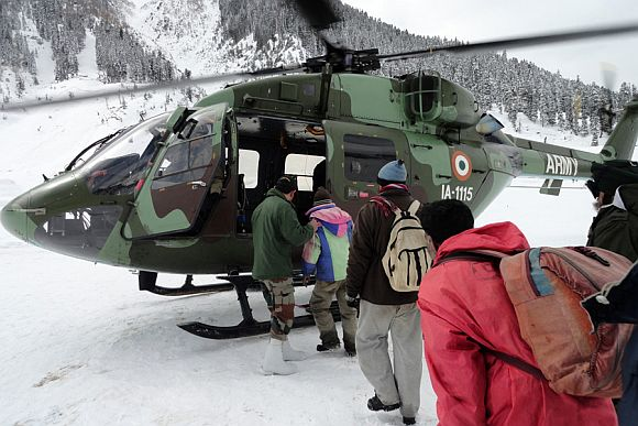 Snow trapped people evacuated by an army helicopter in avalanche-hit Sonamarg