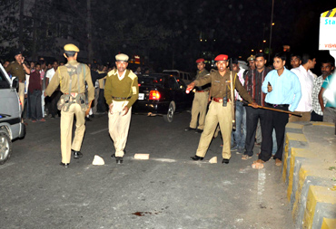 Security personnel inspect the blast site at Ganeshguri area in Guwahati