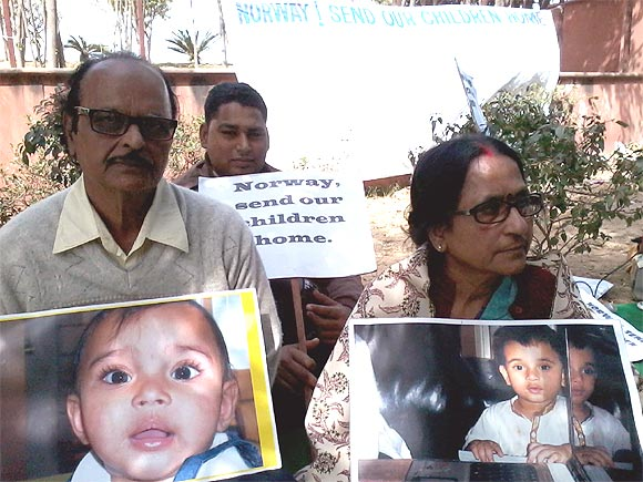 Family members of the Avigan and Aishwariya Bhattacharya at the protest in New Delhi