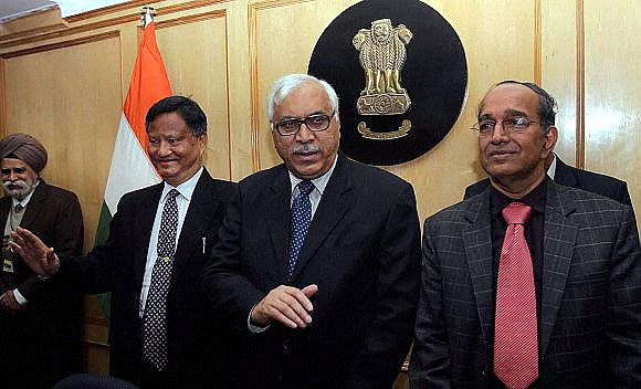 Chief Election Commissioner S Y Quraishi flanked by Election Commissioners V S Sampath, right, and H S Brahma