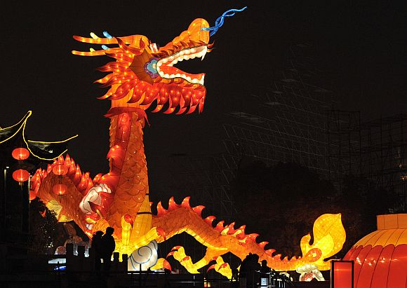A dragon-shaped lantern is lit up at a temple fair in Nanjing, Jiangsu province, in China