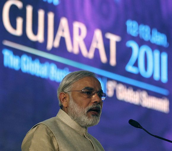 Narendra Modi speaks during the Vibrant Gujarat Global Investors' Summit 2011 at Gandhinagar