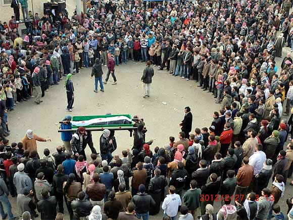 Anti-government protesters attend the funeral of Jaffar Mahmoud, whom they said was killed during clashes with government troops in earlier protests against Syria's President Bashar al-Assad, in Marat al-Numan
