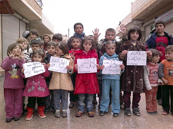 Children take part in a protest against Syria's President Bashar al-Assad in Kafranbel, near Idlib