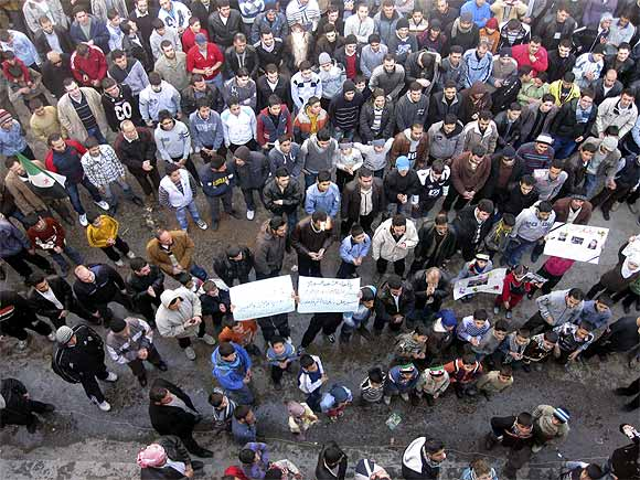 Demonstrators protest against Syria's President Bashar al-Assad in Alwar near Homs