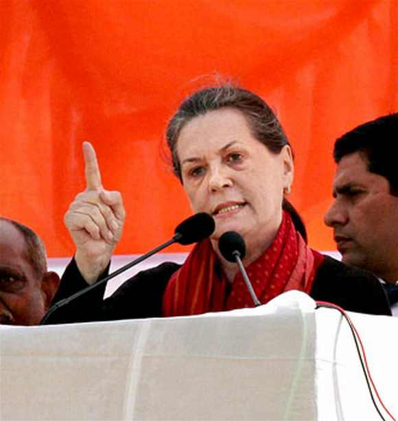 Sonia Gandhi delivers a speech during her election camapaign for the UP polls