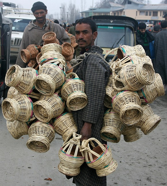 A man selling traditional kangris