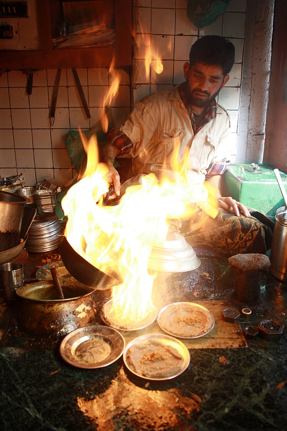 A local cook preparing harisa