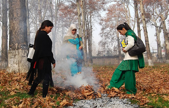 Local women warm themselves
