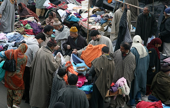 Locals buy warm clothes at a local market