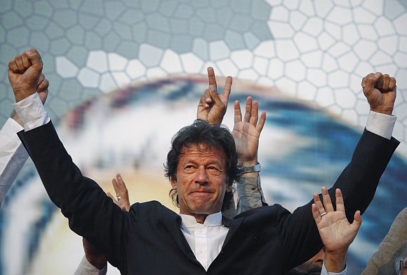 Imran Khan, Pakistani cricketer turned politician, gestures after arriving to lead the Pakistan Tehreek-e- Insaf (PTI) rally in Lahore.