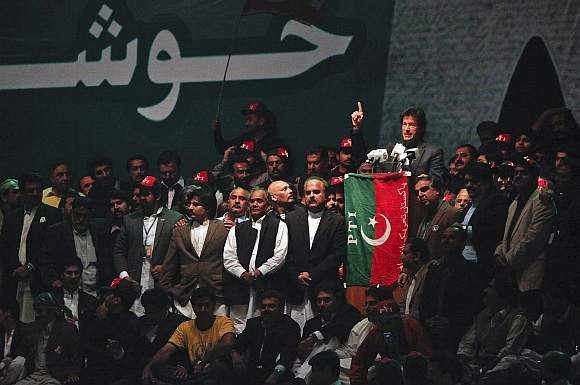 Imran Khan gestures while delivering a speech to lead the Pakistan Tehreek-e- Insaf rally on December 25, 2011 in Karachi.