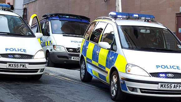 An armed police convoy transporting Kiaran Stapleton arrives at Manchester magistrates' court in northern England
