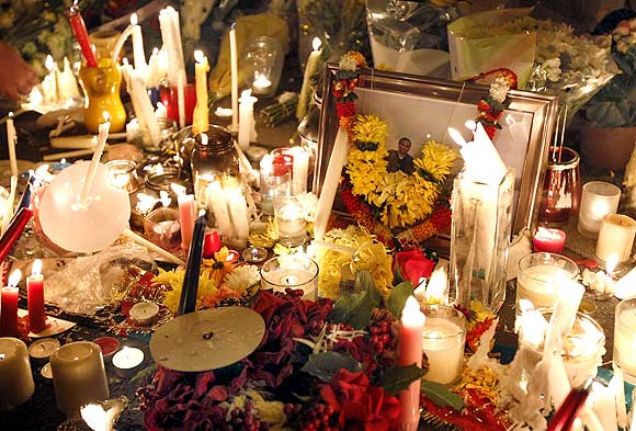 Candles stand alongside a photograph of Anuj Bidve during a candle-light vigil at the spot where he was murdered in Salford, northern England