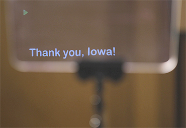 An onstage teleprompter screen reads 'Thank You, Iowa'