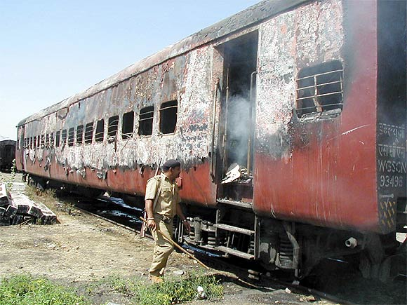 The burnt carriage of a train after the Godhra incident