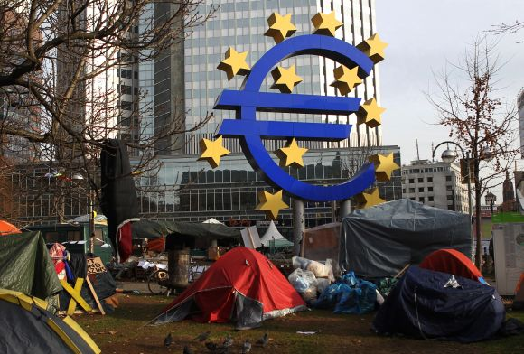 Tents of 'Occupy Frankfurt' movement are pictured next to Euro currency sign sculpture in front of ECB headquarters in Frankfurt, Germany