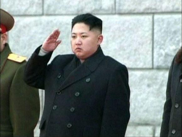 North Korea's new leader Kim Jong-un salutes during the funeral of late North Korean leader Kim Jong-il in Pyongyang