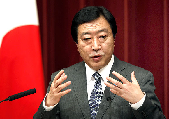Japan's Prime Minister Yoshihiko Noda speaks at a news conference in Tokyo
