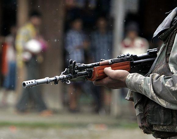 An Indian soldier stands guard in Medo village, Arunachal Pradesh, near the Indo-China border