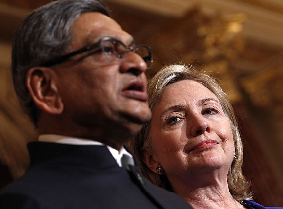 File image of US Secretary of State Clinton listening to a speech by S M Krishna in Washington, DC