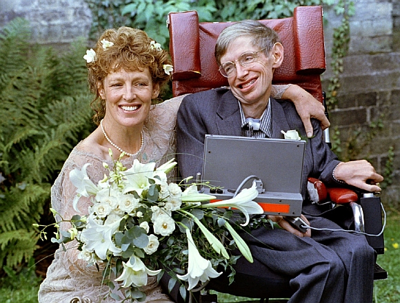 Stephen Hawking and his wife Elaine Mason pose for pictures after the blessing of their wedding on September 16, 1995