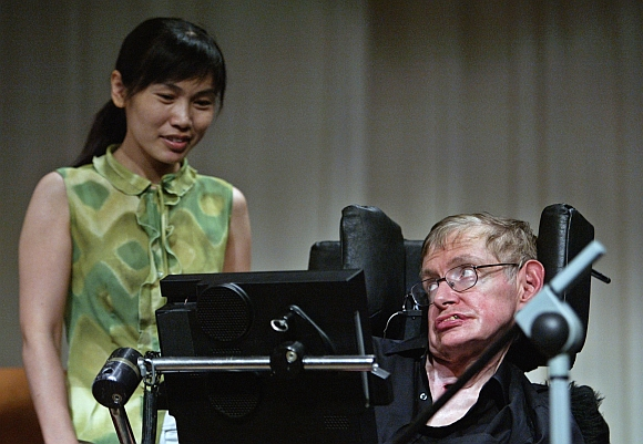 Hawking from the University of Cambridge, one of the world's leading theoretical physicists, is greeted by a Chinese student in Beijing