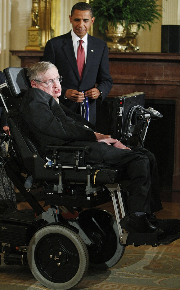 US President Barack Obama presents the Medal of Freedom to renowned physicist Stephen Hawking during a ceremony in the East Room at the White House in Washington