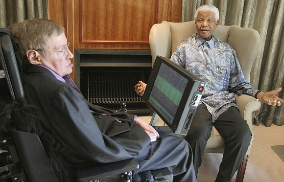Former South African President Nelson Mandela meets theoretical physicist Professor Stephen Hawking at Mandela's Foundation office in Johannesburg