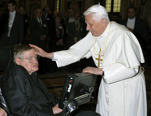 Pope Benedict XVI greets British professor Stephen Hawking during a meeting of science academics at the Vatican