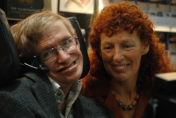 British astrophysicist Professor Stephen Hawking and his wife Elaine visit the stand of German bookseller Rowohlt at the Frankfurt book fair