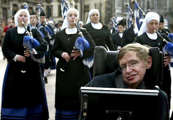 Hawking is surrounded by pipers as he arrives at Oviedo's cathedral in Spain