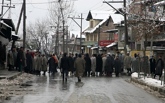 Youths block a road in Srinagar as they protest against the frequent power cuts in the Valley