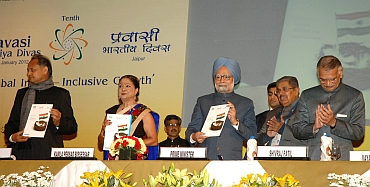 Dr Singh releases a book at the 10th Pravasi Bharatiya Divas