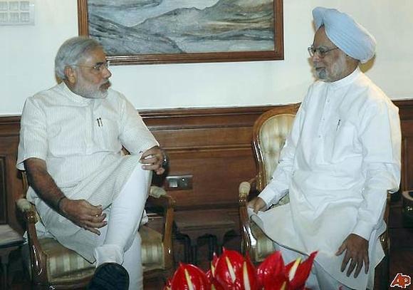 Modi with Prime Minister Manmohan Singh