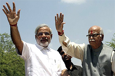 BJP leaders Narendra Modi and L K Advani