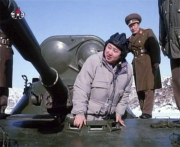 New leader of North Korea Kim Jong-un inspects an armoured vehicle in this undated still image taken from video